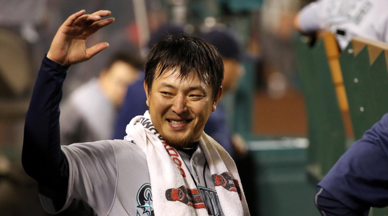 Seattle Mariners pitcher Hisashi Iwakuma, of Japan, celebrates with teammates after coming out of the baseball game against the Los Angeles Angels after seven innings Anaheim, Calif., Thursday, Aug. 18, 2016. The Angels won, 6-4. (AP Photo/Reed Saxon)