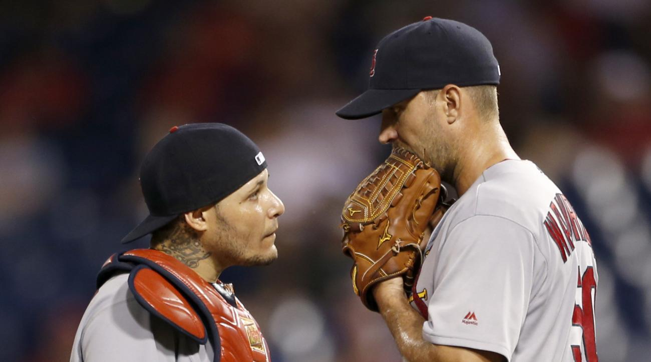 St. Louis Cardinals catcher Yadier Molina, left, confers with starting pitcher Adam Wainwright after Wainwright gave up two home runs to the Philadelphia Phillies in the sixth inning of a baseball game, Friday, Aug. 19, 2016, in Philadelphia. (AP Photo/La