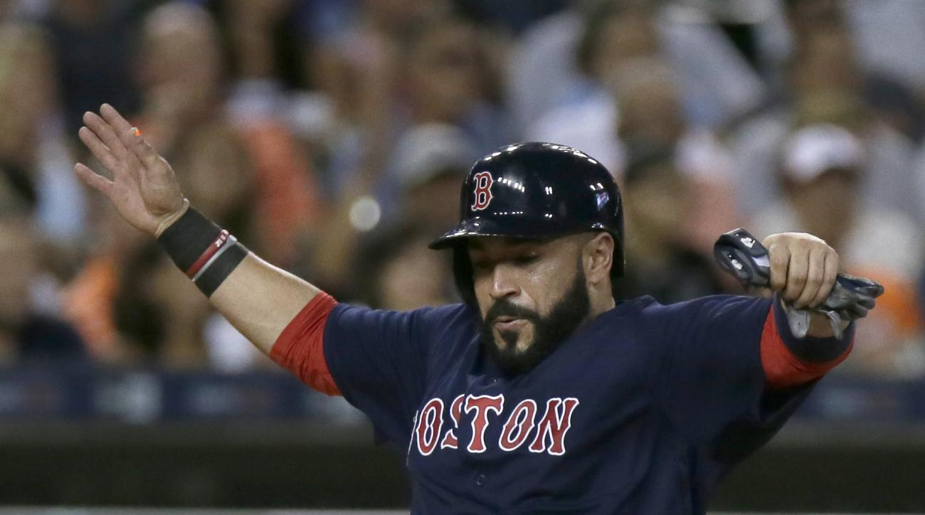 Boston Red Sox's Sandy Leon scores from second base on a single by Dustin Pedoria during the sixth inning of a baseball game against the Detroit Tigers on Friday, Aug. 19, 2016, in Detroit. (AP Photo/Duane Burleson)