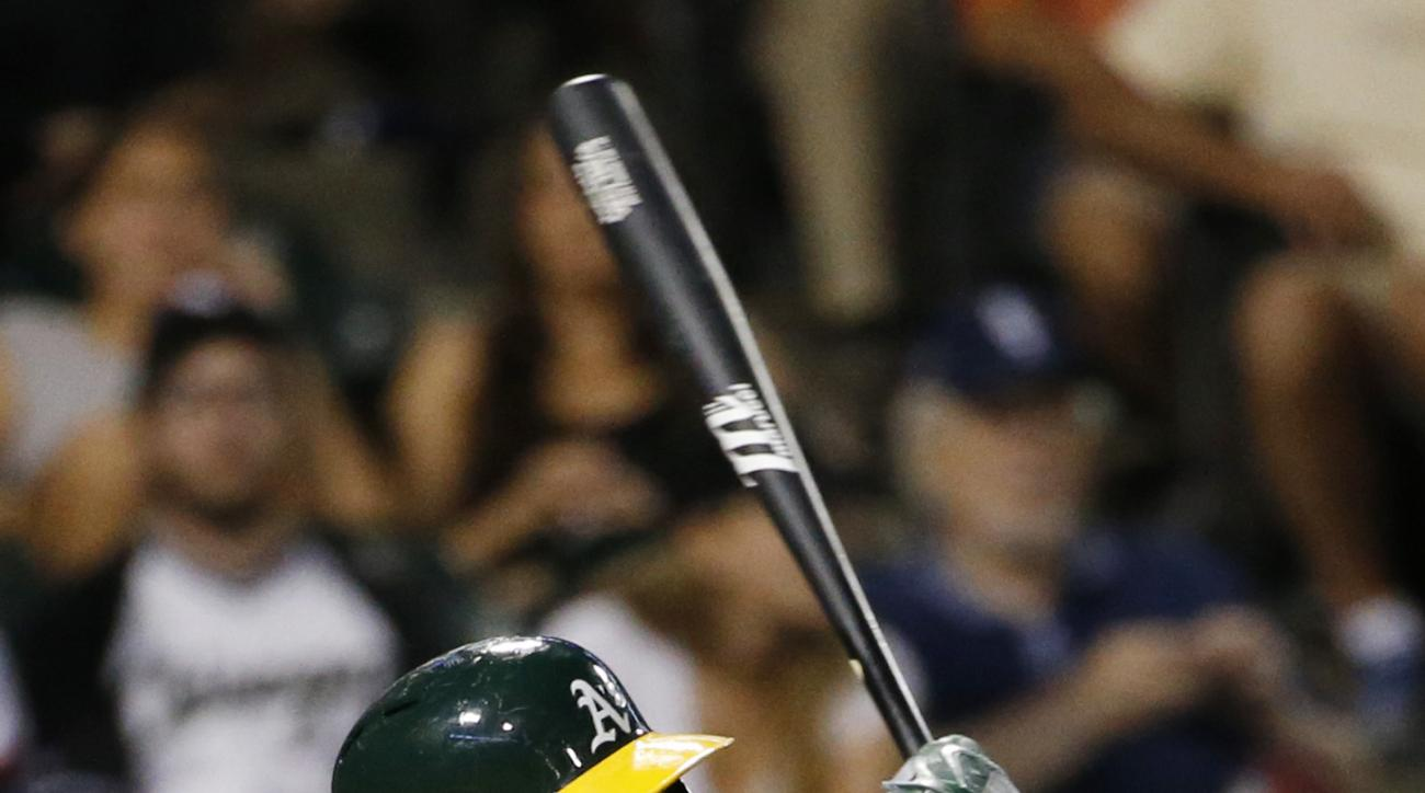 Oakland Athletics' Danny Valencia hits a double during the sixth inning of a baseball game against the Chicago White Sox in Chicago, Friday, Aug.19, 2016. (AP Photo/Nam Y. Huh)