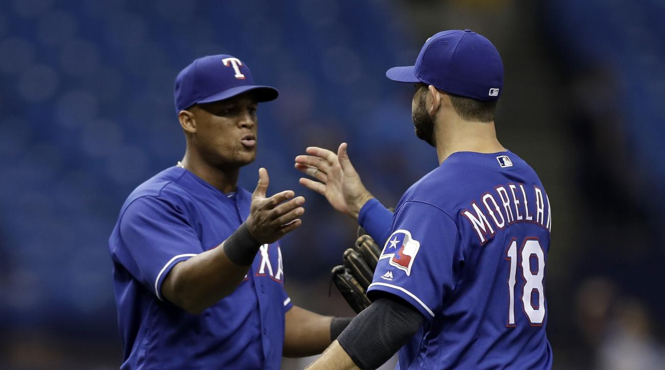 Texas Rangers third baseman Adrian Beltre, left, and first baseman Mitch Moreland celebrates their win over the Tampa Bay Rays in a baseball game Friday, Aug. 19, 2016, in St. Petersburg, Fla. (AP Photo/Chris O'Meara)