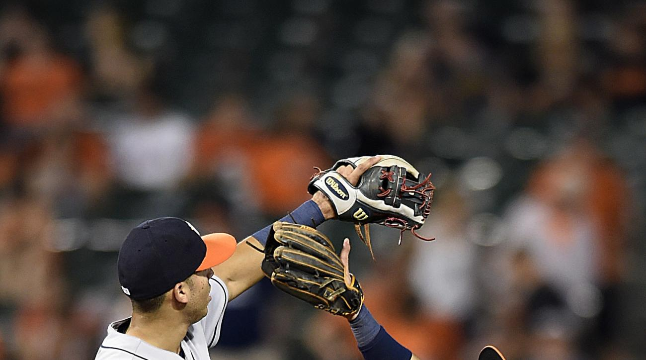 Houston Astros' Carlos Correa, left, and Jose Altuve celebrate the Astros' 15-8 win over the Baltimore Orioles in a baseball game, Friday, Aug. 19, 2016, in Baltimore. (AP Photo/Gail Burton)