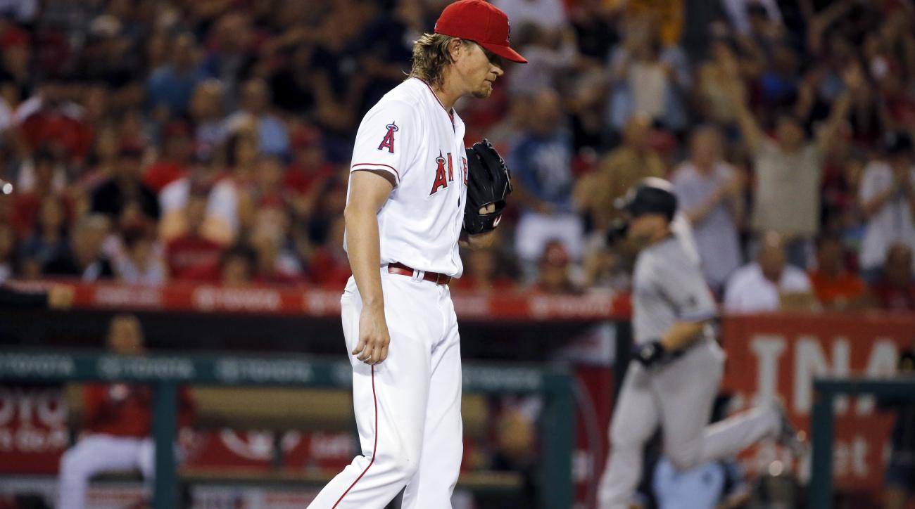 Los Angeles Angels starting pitcher Jared Weaver walks to the mound as New York Yankees' Brian McCann circles the bases on a home run during the fifth inning of a baseball game in Anaheim, Calif., Friday, Aug. 19, 2016. Weaver was pulled from the game aft