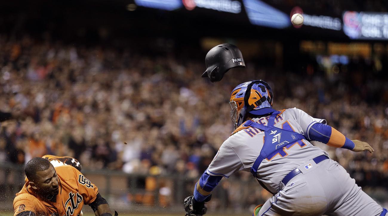 San Francisco Giants' Eduardo Nunez, left, slides to score past New York Mets catcher Rene Rivera during the seventh inning of a baseball game Friday, Aug. 19, 2016, in San Francisco. (AP Photo/Ben Margot)