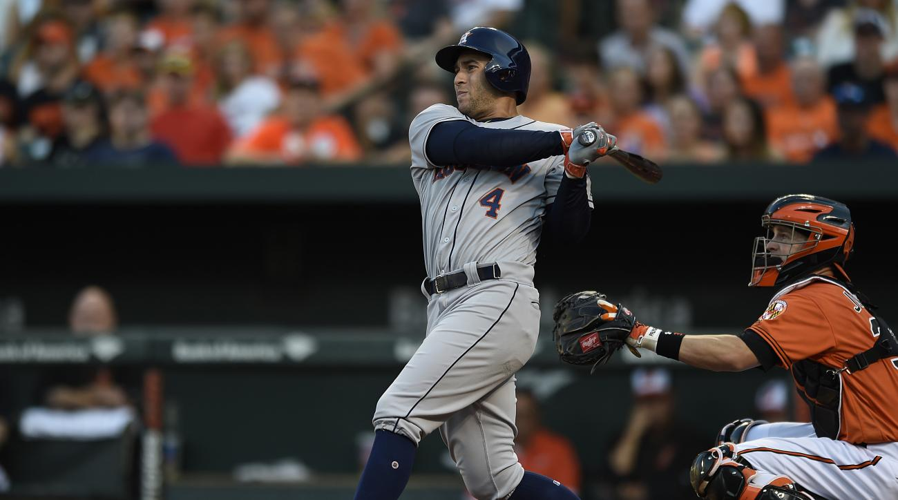 Houston Astros' George Springer follows through on a single against the Baltimore Orioles in the first inning of a baseball game, Saturday, Aug. 20, 2016, in Baltimore. (AP Photo/Gail Burton)