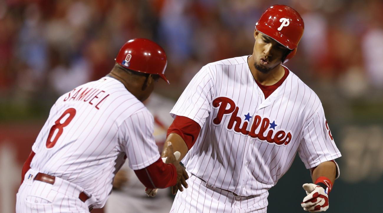 Philadelphia Phillies' Aaron Altherr, right, is congratulated by third base coach Juan Samuel after hitting a home run off St. Louis Cardinals relief pitcher Jonathan Broxton during the sixth inning of a baseball game, Saturday, Aug. 20, 2016, in Philadel
