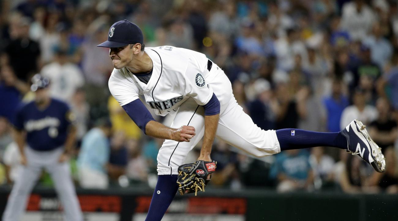 Seattle Mariners closing pitcher Steve Cishek throws against the Milwaukee Brewers during the ninth inning of a baseball game Saturday, Aug. 20, 2016, in Seattle. The Mariners won 8-2. (AP Photo/Elaine Thompson)