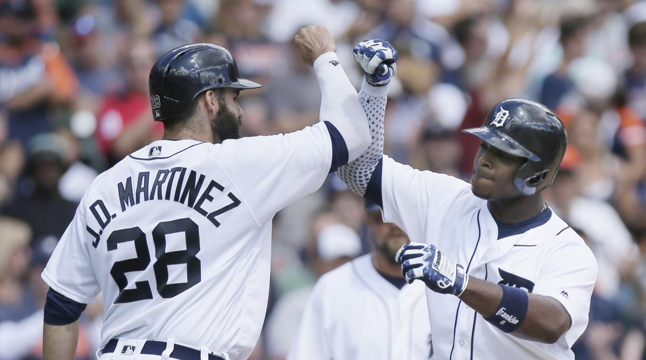 Detroit Tigers' Justin Upton, right, celebrates with J.D. Martinez after hitting a three-run home run against the Boston Red Sox during the third inning of a baseball game, Sunday, Aug. 21, 2016, in Detroit. (AP Photo/Duane Burleson)