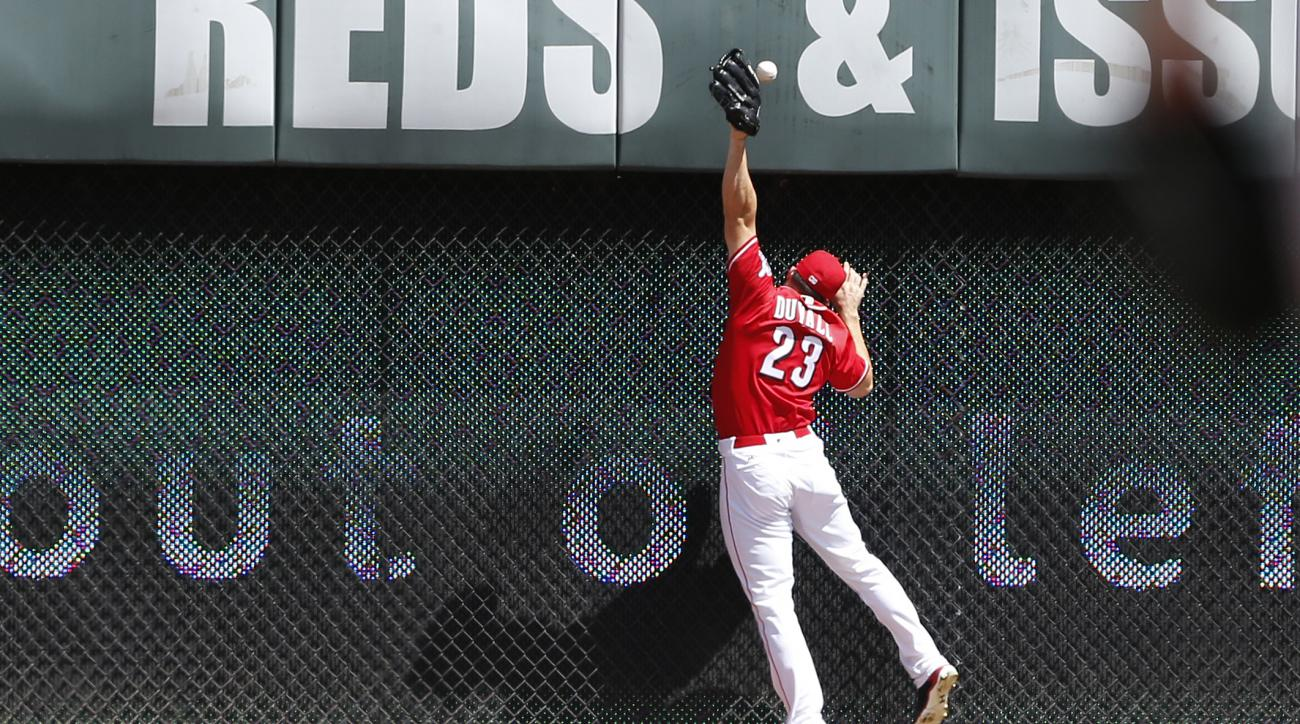Cincinnati Reds left fielder Adam Duvall (23) cannot get to a double off the bat of Los Angeles Dodgers' Yasmani Grandal during the sixth inning of a baseball game, Sunday, Aug. 21, 2016, in Cincinnati. (AP Photo/Gary Landers)