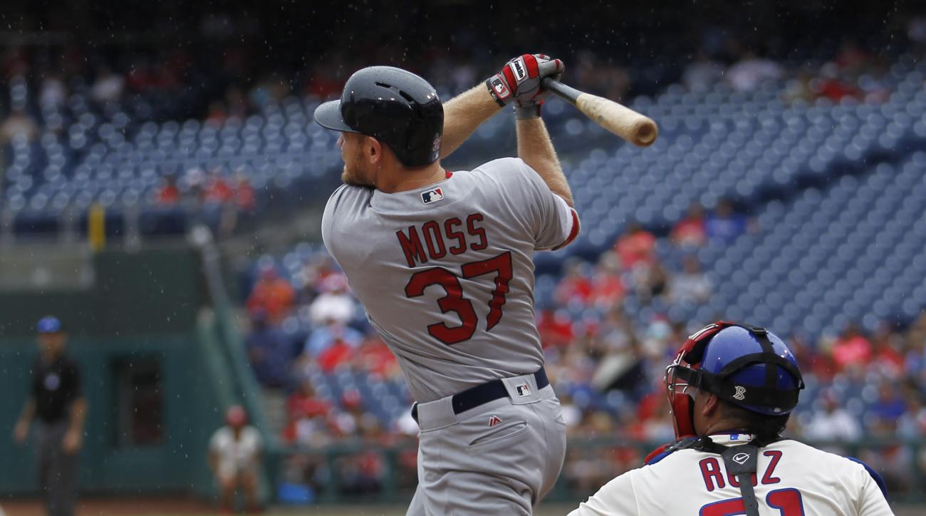 St. Louis Cardinals' Brandon Moss follows through on a home run off Philadelphia Phillies starting pitcher Vince Velasquez in the fourth inning of a baseball game, Sunday, Aug. 21, 2016, in Philadelphia. (AP Photo/Laurence Kesterson)
