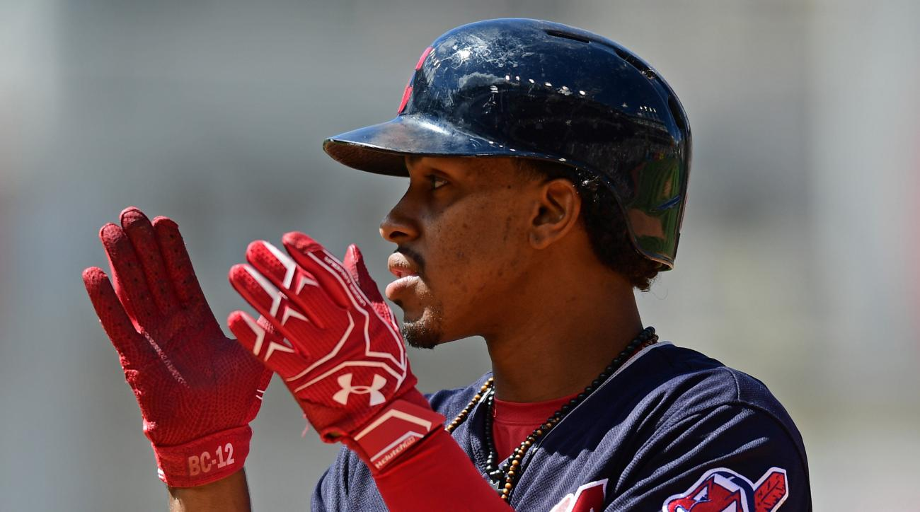 Cleveland Indians' Francisco Lindoer celebrates after hitting an RBI-single that scored Carlos Santana in the sixth inning of a baseball game against the Toronto Blue Jays, Sunday, Aug. 21, 2016, in Cleveland. (AP Photo/David Dermer)