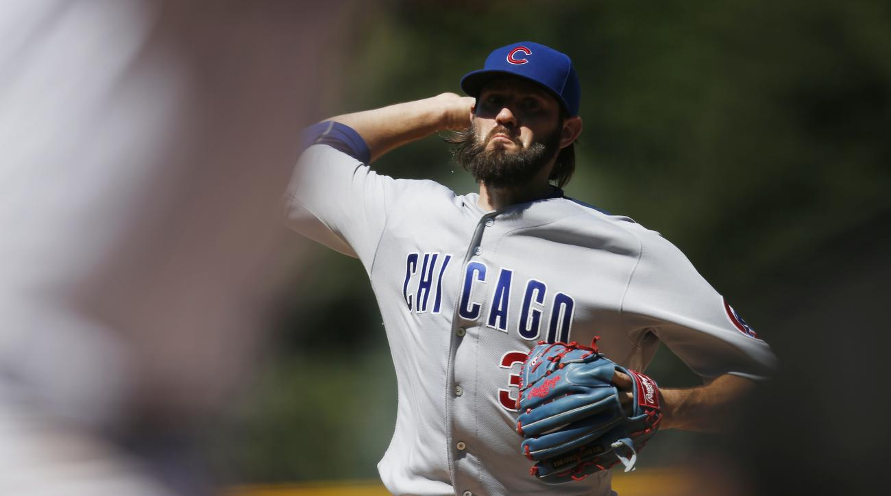 Chicago Cubs starting pitcher Jason Hammel delivers to Colorado Rockies' DJ LeMahieu in the first inning of a baseball game Sunday, Aug. 21, 2016, in Denver. (AP Photo/David Zalubowski)