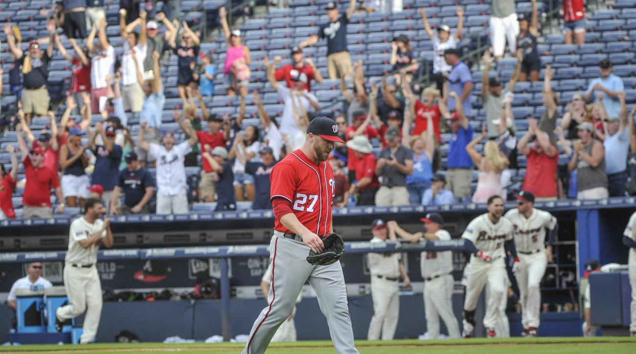 Washington Nationals pitcher Shawn Kelley walks off the field as the walk off home run ball of Atlanta Braves' Jace Peterson sails to the right field wall during the tenth inning of a baseball game, Sunday, Aug. 21, 2016, in Atlanta. Atlanta won 7-6. (AP
