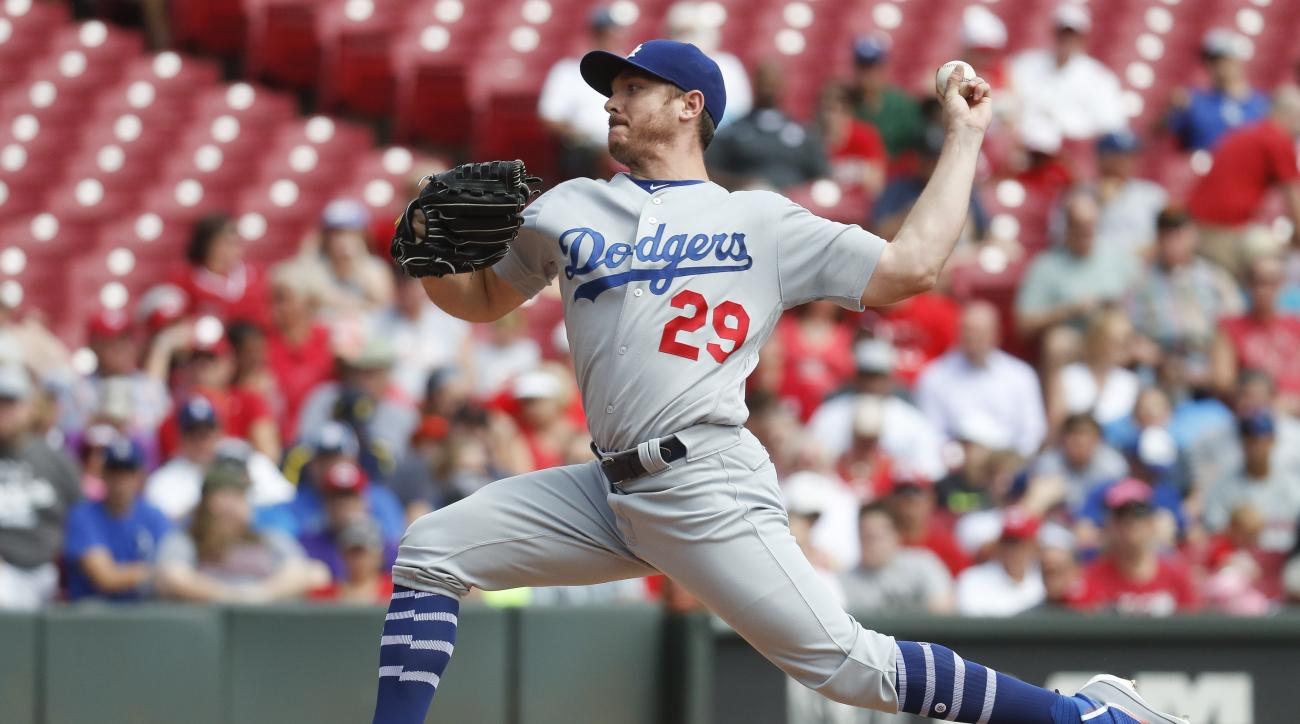 Los Angeles Dodgers starting pitcher Scott Kazmir throws in the first inning of a baseball game against the Cincinnati Reds, Monday, Aug. 22, 2016, in Cincinnati. (AP Photo/John Minchillo)