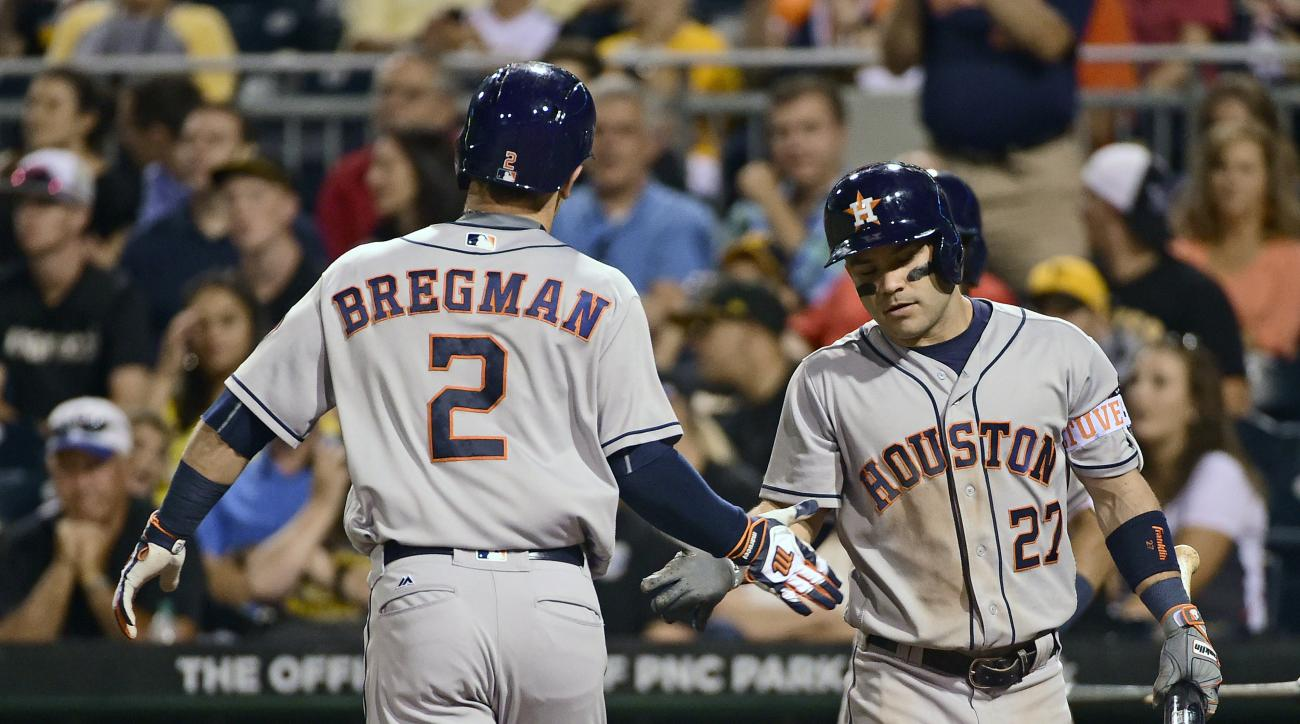 Houston Astros' Alex Bregman is congratulated by Jose Altuve in the ninth inning of a baseball game against the Pittsburgh Pirates in Pittsburgh, Monday, Aug. 22, 2016. (AP Photo/Fred Vuich)