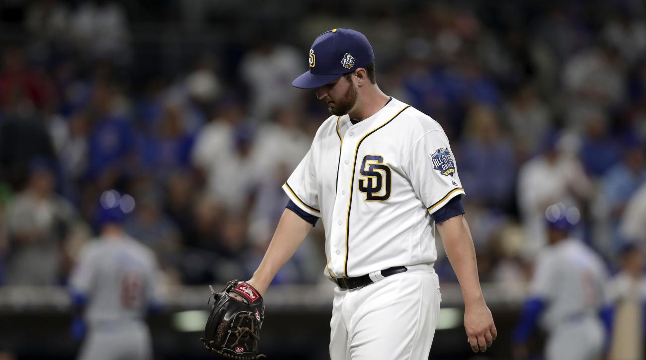San Diego Padres relief pitcher Keith Hessler walks back to the dugout during the seventh inning of a baseball game against the Chicago Cubs, Monday, Aug. 22, 2016, in San Diego. (AP Photo/Ryan Kang)