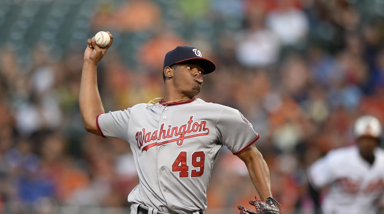 Washington Nationals starting pitcher Reynaldo Lopez delivers a pitch during the first inning of a baseball game against the Baltimore Orioles, Tuesday, Aug. 23, 2016, in Baltimore. (AP Photo/Nick Wass)