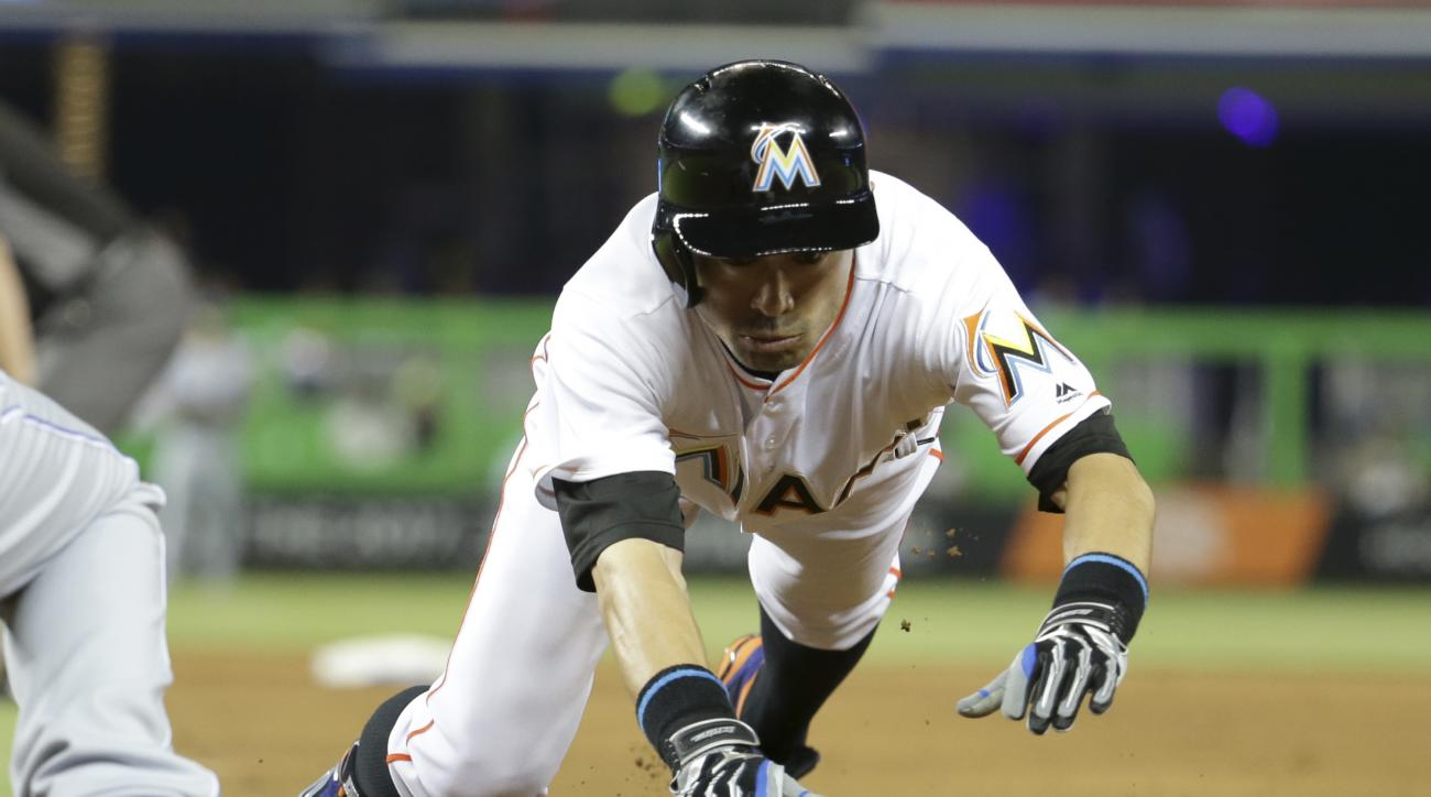 Miami Marlins' Ichiro Suzuki dives safely back to first during the fourth inning of a baseball game against the Kansas City Royals, Tuesday, Aug. 23, 2016, in Miami. (AP Photo/Lynne Sladky)