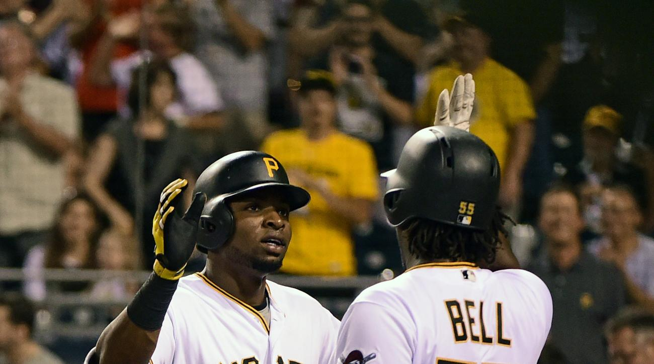 Pittsburgh Pirates' Gregory Polanco, left, is congratulated by Josh Bell after hitting a solo home run during the fifth inning of a baseball game against the Houston Astros in Pittsburgh, Tuesday, Aug. 23, 2016. (AP Photo/Fred Vuich)