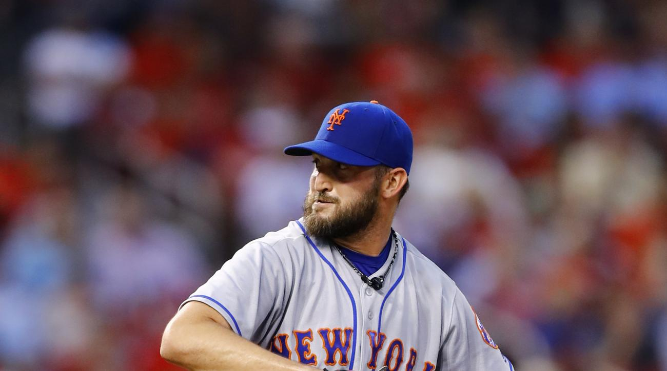 New York Mets starting pitcher Jonathon Niese winds up during the first inning of a baseball game against the St. Louis Cardinals, Tuesday, Aug. 23, 2016, in St. Louis. (AP Photo/Billy Hurst)