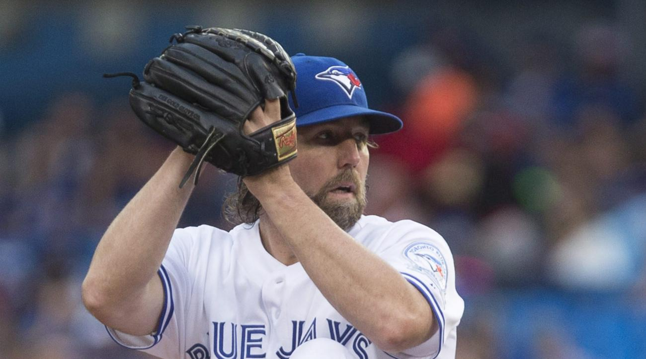 Toronto Blue Jays starting pitcher R.A. Dickey works against the Los Angeles Angels during the first inning of a baseball game Tuesday, Aug. 23, 2016, in Toronto. (Chris Young/The Canadian Press via AP)