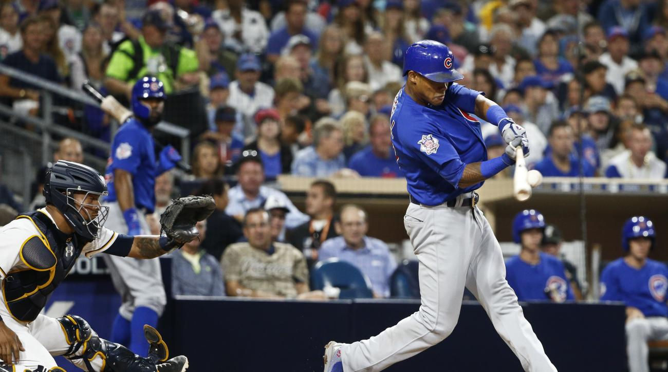 Chicago Cubs' Addison Russell hits a two-run home run against the San Diego Padres during the fifth inning of a baseball game Tuesday, Aug. 23, 2016, in San Diego. (AP Photo/Lenny Ignelzi)