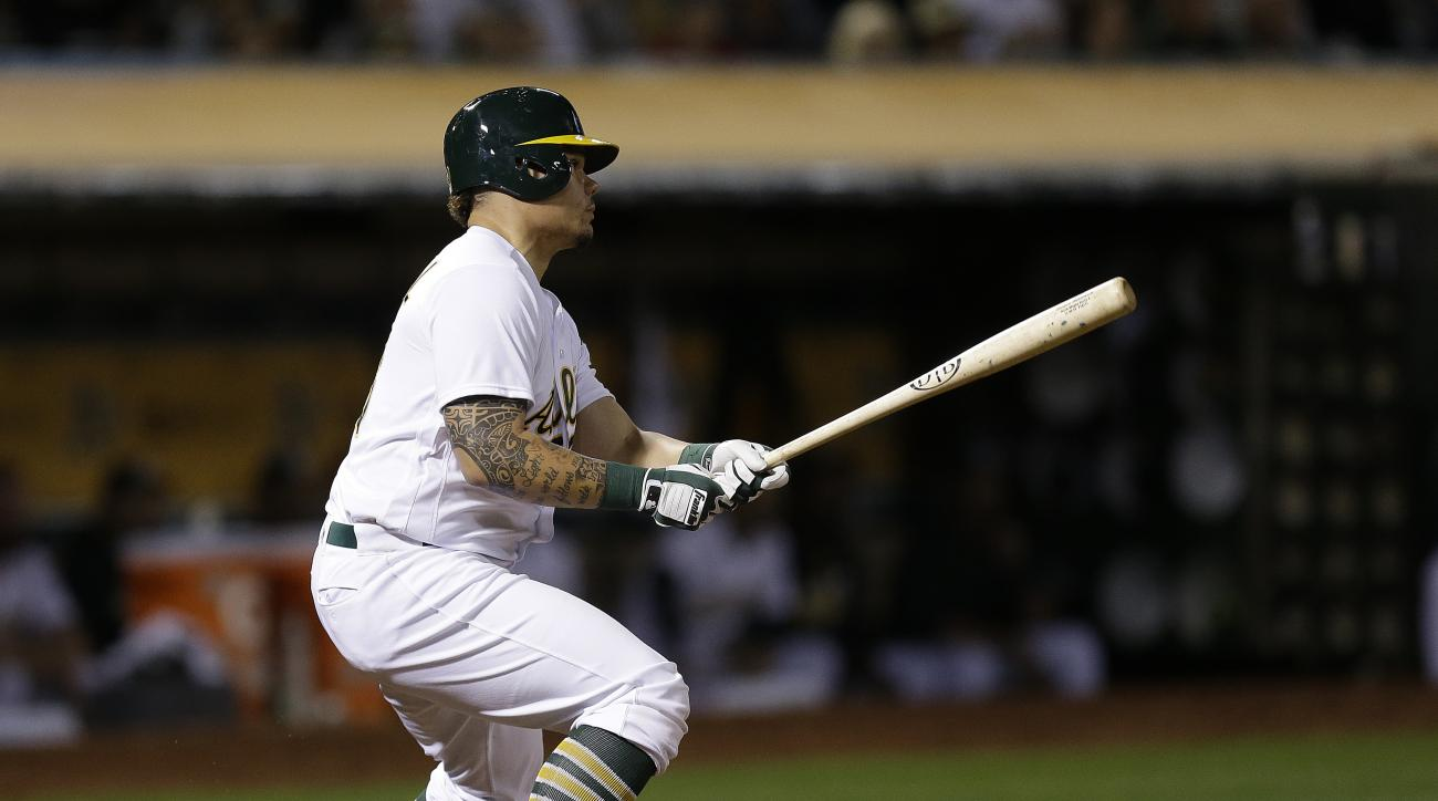 Oakland Athletics' Bruce Maxwell watches his two-run double off Cleveland Indians' Mike Clevinger during the eighth inning of a baseball game Tuesday, Aug. 23, 2016, in Oakland, Calif. (AP Photo/Ben Margot)