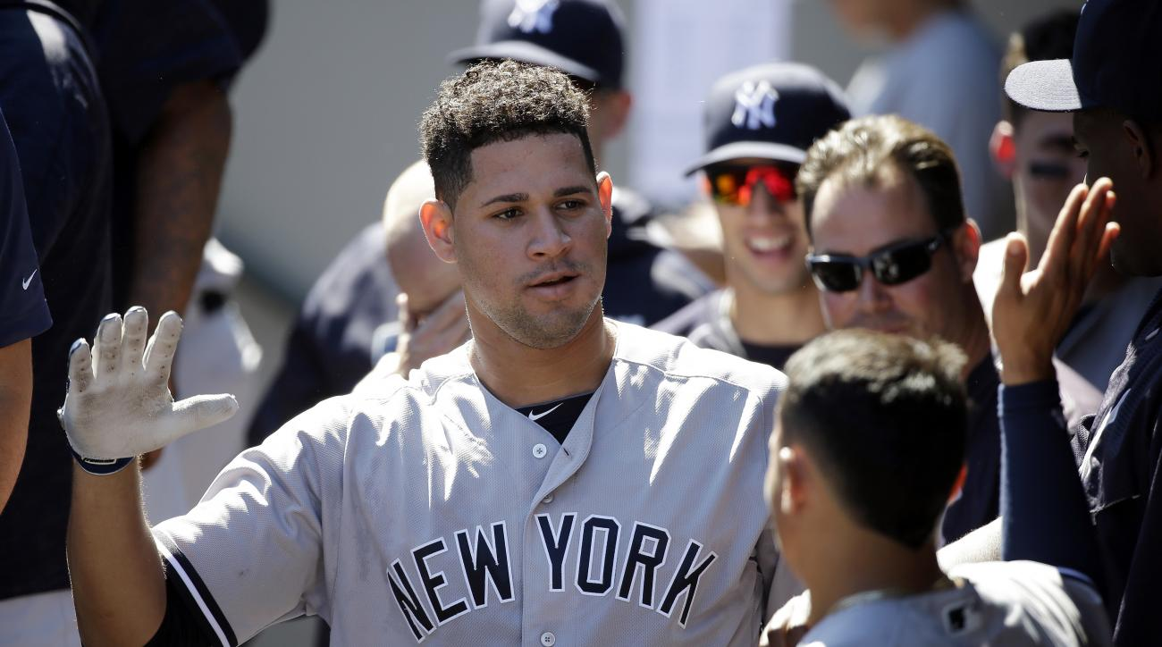 New York Yankees' Gary Sanchez is congratulated on his home run against the Seattle Mariners in the first inning of a baseball game Wednesday, Aug. 24, 2016, in Seattle. (AP Photo/Elaine Thompson)