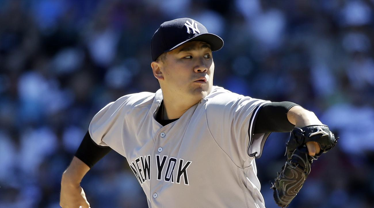 New York Yankees starting pitcher Masahiro Tanaka throws against the Seattle Mariners in the first inning of a baseball game Wednesday, Aug. 24, 2016, in Seattle. (AP Photo/Elaine Thompson)