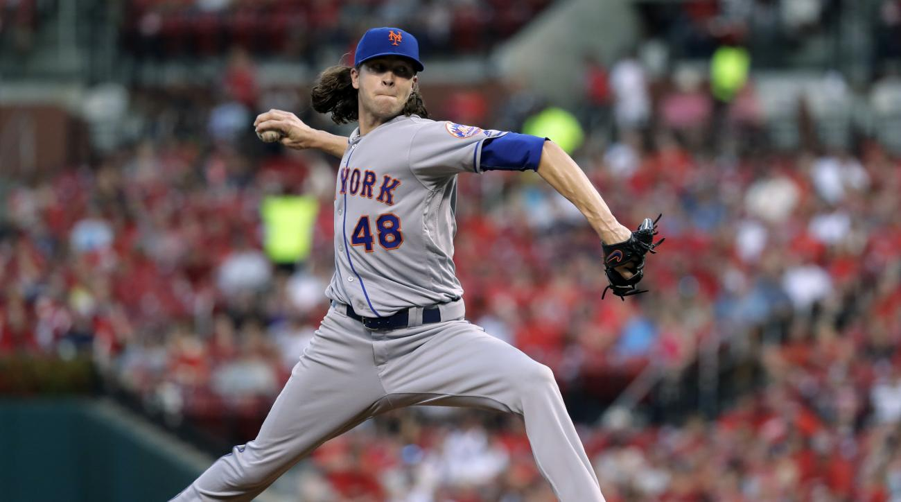 New York Mets starting pitcher Jacob deGrom throws during the first inning of a baseball game against the St. Louis Cardinals on Wednesday, Aug. 24, 2016, in St. Louis. (AP Photo/Jeff Roberson)