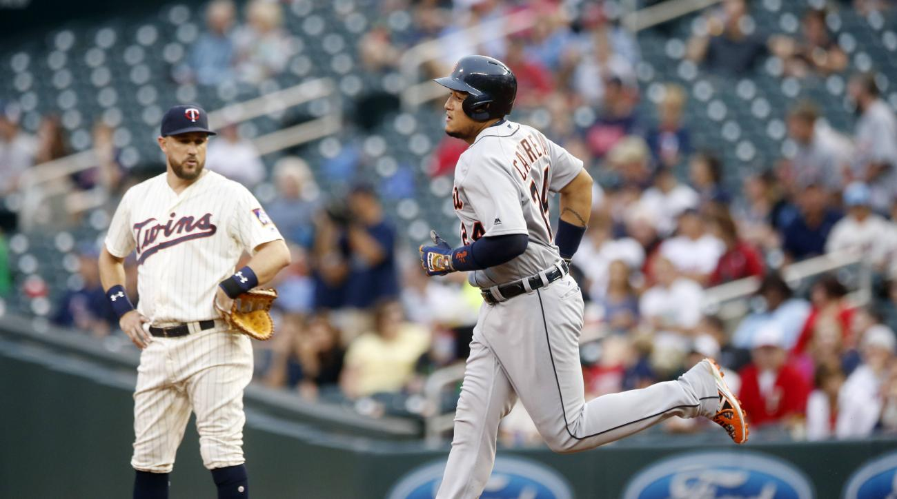 Detroit Tigers' Miguel Cabrera, right, jogs past Minnesota Twins first baseman Trevor Plouffe on a solo home run off Minnesota Twins pitcher Tyler Duffey in the first inning of a baseball game Wednesday, Aug. 24, 2016, in Minneapolis. (AP Photo/Jim Mone)