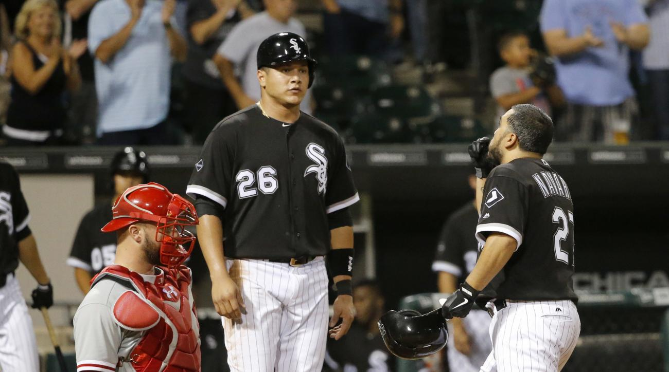 Chicago White Sox's Dioner Navarro, right, celebrates his two-run home run with Avisail Garcia (26) as Philadelphia Phillies catcher Cameron Rupp waits during the sixth inning of a baseball game Wednesday, Aug. 24, 2016, in Chicago. (AP Photo/Charles Rex