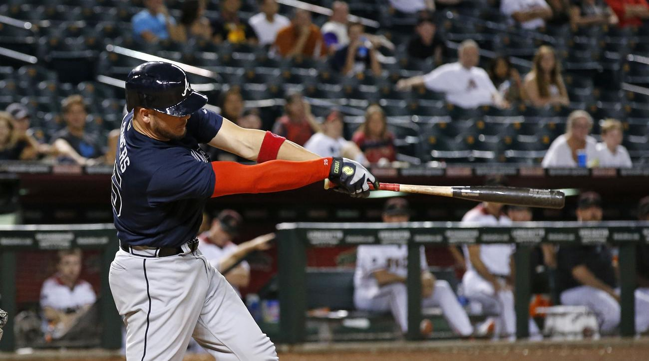 Atlanta Braves' Tyler Flowers follows through on a run-scoring double against the Arizona Diamondbacks during the ninth inning of a baseball game Wednesday, Aug. 24, 2016, in Phoenix. (AP Photo/Ross D. Franklin)