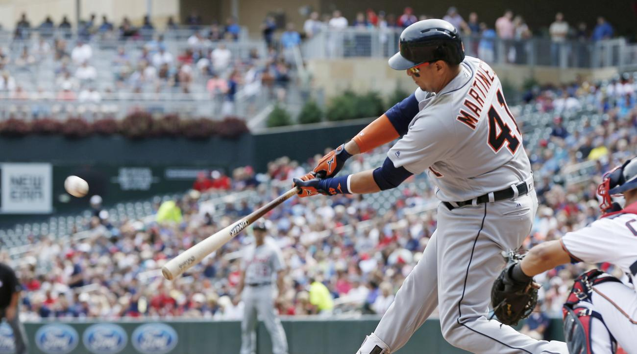 Detroit Tigers' Victor Martinez hits a two-run double off Minnesota Twins pitcher Michael Tonkin in the sixth inning of a baseball game Thursday, Aug. 25, 2016, in Minneapolis. (AP Photo/Jim Mone)