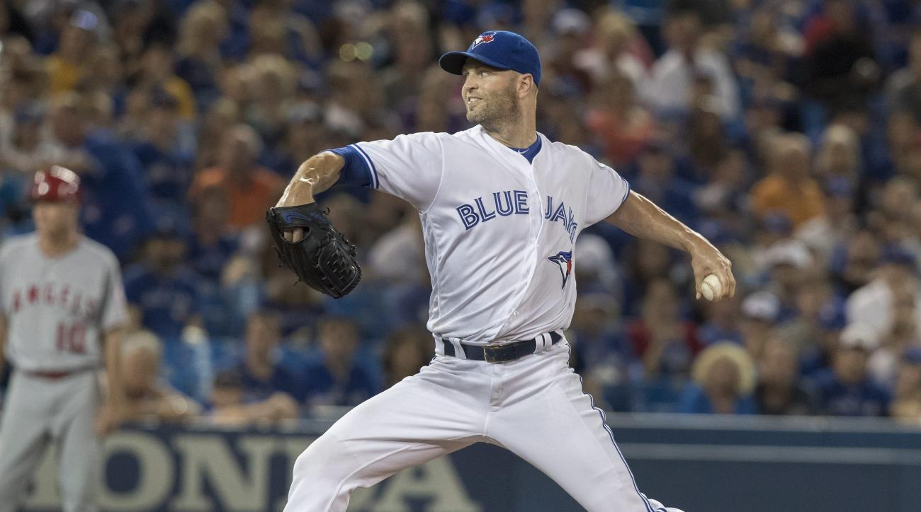 Toronto Blue Jays starting pitcher J.A. Happ throws to the Los Angeles Angels during the first  inning of a baseball game Thursday, Aug. 25. 2016, in Toronto. (Fred Thornhill/The Canadian Press via AP)