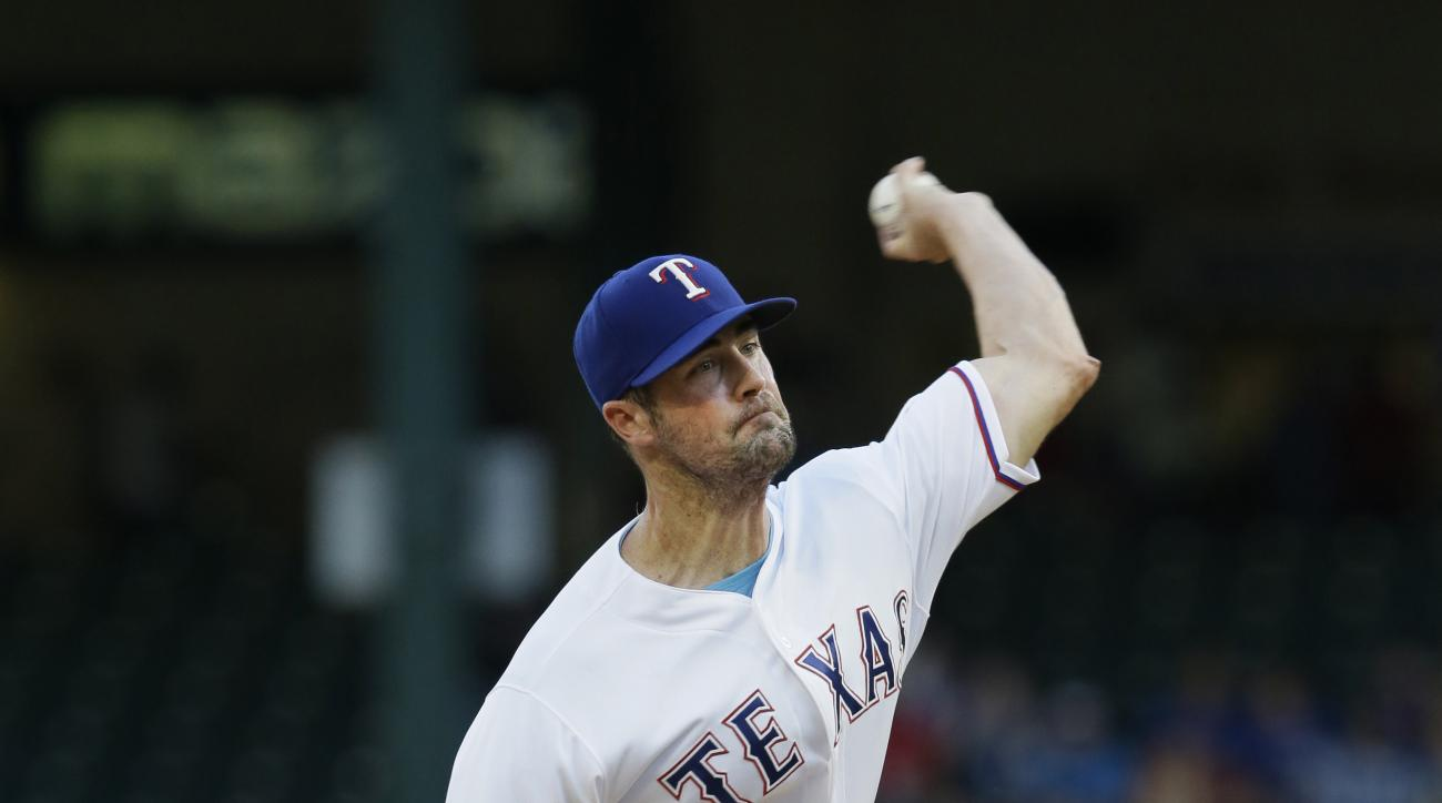 Texas Rangers starting pitcher Cole Hamels throws during the first inning of a baseball game against the Cleveland Indians in Arlington, Texas, Thursday, Aug. 25, 2016. (AP Photo/LM Otero)