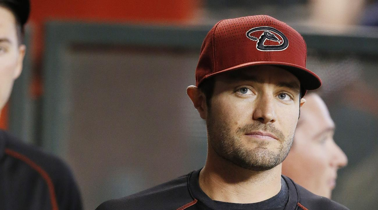 An injured Arizona Diamondbacks' A.J. Pollock paces in the dugout wearing an elbow brace prior to a baseball game against the Pittsburgh Pirates Sunday, April 24, 2016, in Phoenix.  The Pirates defeated the Diamondbacks 12-10. (AP Photo/Ross D. Franklin)