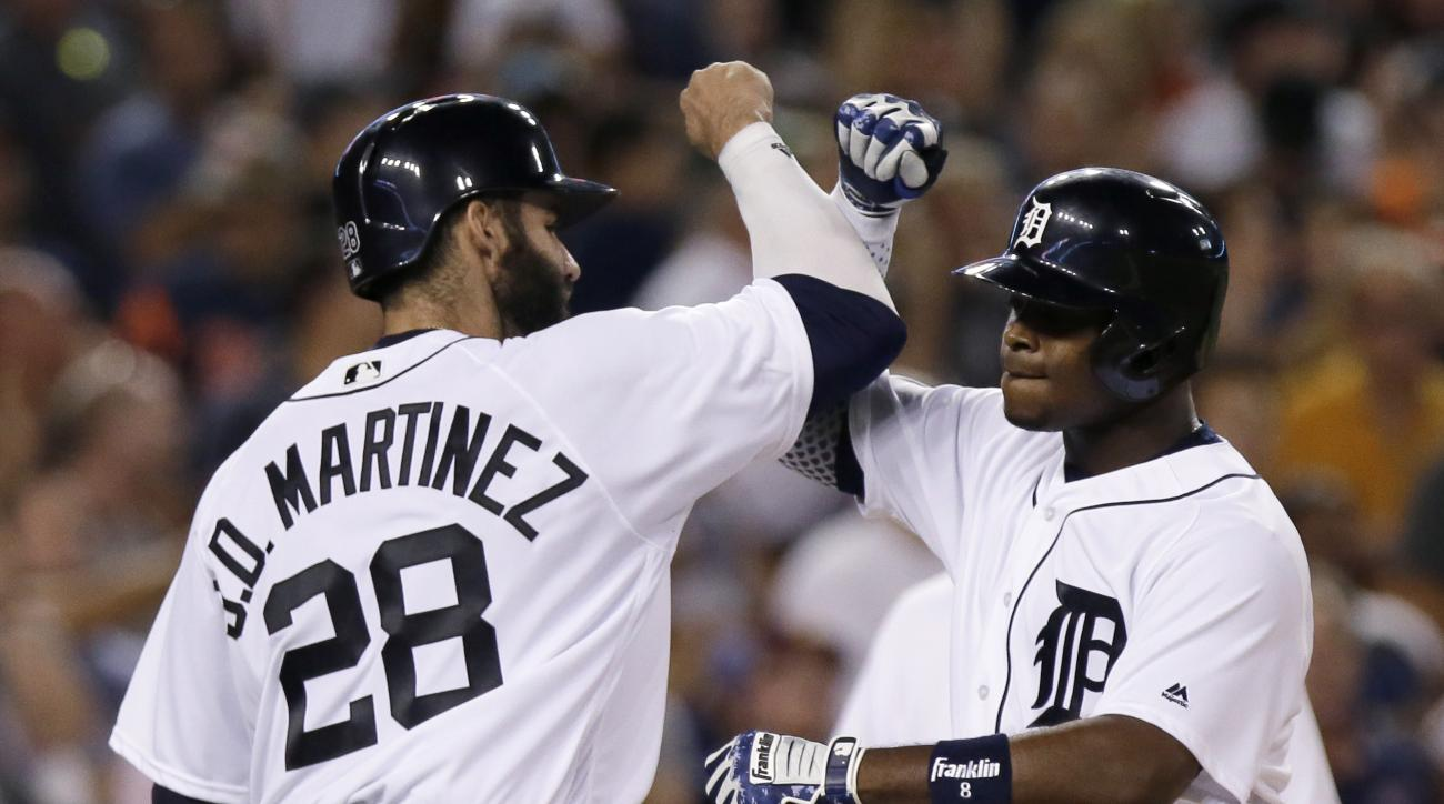 Detroit Tigers' Justin Upton celebrates with J.D. Martinez after hitting a two-run home run against the Los Angeles Angels during the sixth inning of a baseball game Friday, Aug. 26, 2016, in Detroit. (AP Photo/Duane Burleson)