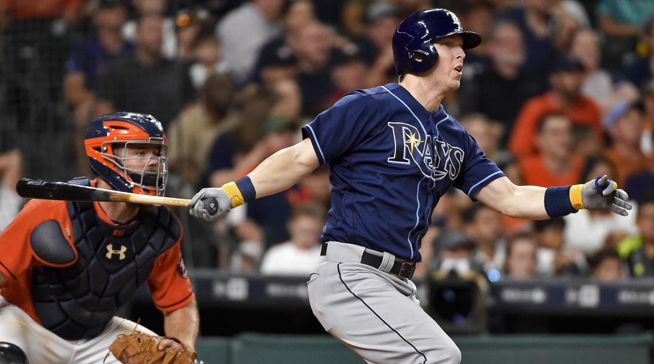 Tampa Bay Rays designated hitter Corey Dickerson watches his RBI double during the seventh inning of a baseball game against the Houston Astros, Friday, Aug. 26, 2016, in Houston. (AP Photo/Eric Christian Smith)