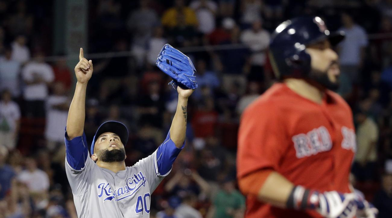 Kansas City Royals relief pitcher Kelvin Herrera (40) celebrates as Boston Red Sox's Sandy Leon grounds out for the last out of a baseball game in the ninth inning at Fenway Park, Friday, Aug. 26, 2016, in Boston. The Royals won 6-3. (AP Photo/Elise Amend