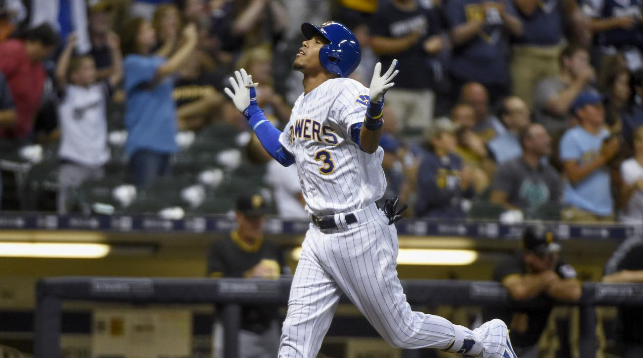 Milwaukee Brewers' Orlando Arcia reacts as he runs the bases after hitting his first home run in the majors, during the sixth inning of a baseball game against the Pittsburgh Pirates on Friday, Aug. 26, 2016, in Milwaukee. (AP Photo/Benny Sieu)