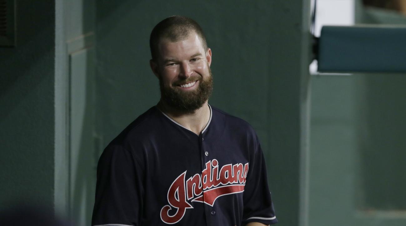 Cleveland Indians starting pitcher Corey Kluber smiles while standing in the dugout during a baseball game against the Texas Rangers in Arlington, Texas, Friday, Aug. 26, 2016. The Indians won 12-1. (AP Photo/LM Otero)