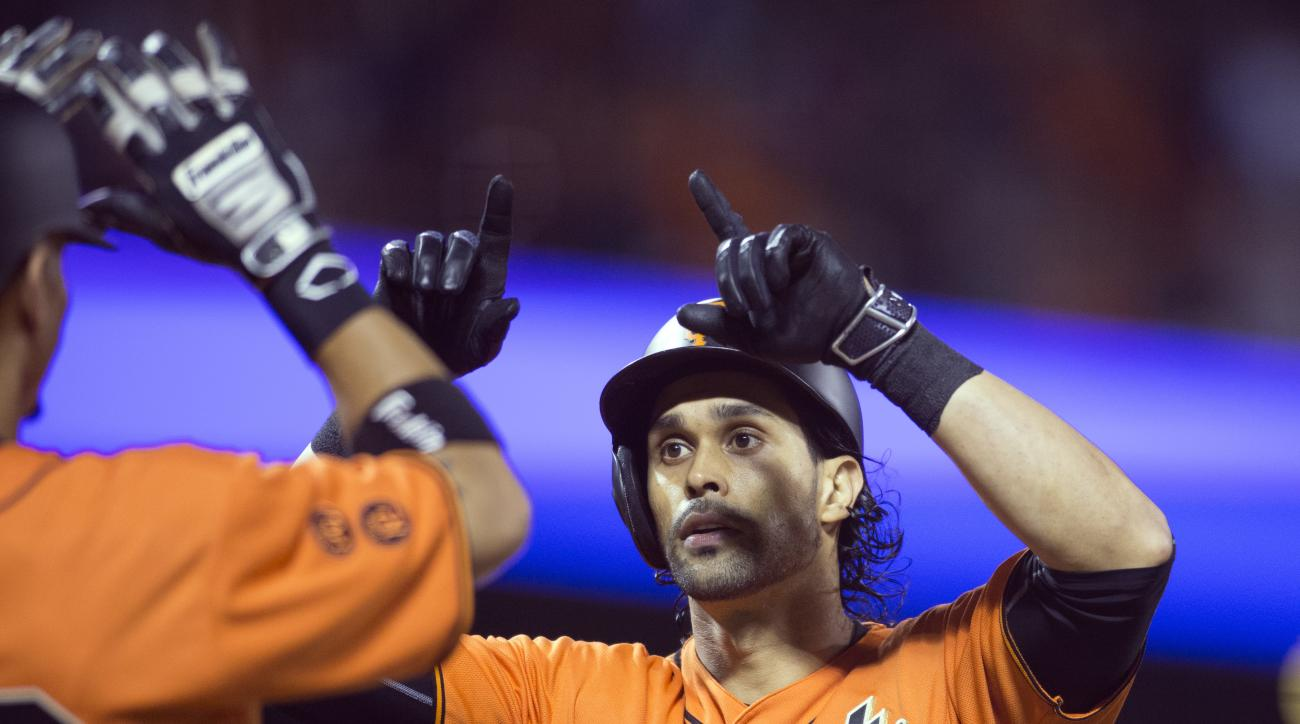 San Francisco Giants' Angel Pagan (16) is greeted by teammate Gorkys Hernandez after hitting a two-run home run off Atlanta Braves starting pitcher Joel De La Cruz during the second inning of a baseball game, Friday, Aug. 26, 2016, in San Francisco. (AP P