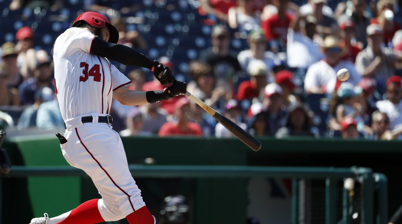 Washington Nationals' Bryce Harper hits an RBI double during the fourth inning of a baseball game against the Colorado Rockies at Nationals Park, Saturday, Aug. 27, 2016, in Washington. (AP Photo/Alex Brandon)