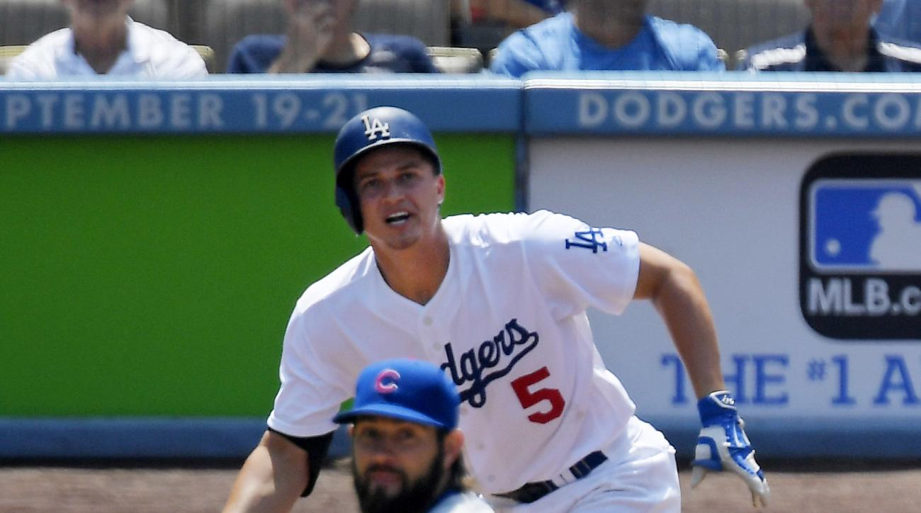 Los Angeles Dodgers' Corey Seager, top, hits a solo home run as Chicago Cubs starting pitcher Jason Hammel watches during the first inning of a baseball game, Saturday, Aug. 27, 2016, in Los Angeles. (AP Photo/Mark J. Terrill)