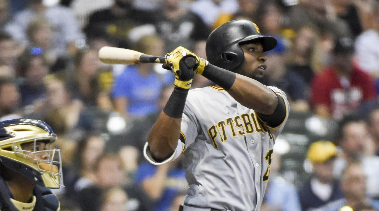 Pittsburgh Pirates' Gregory Polanco watches his three-run double during the sixth inning of a baseball game against the Milwaukee Brewers on Saturday, Aug. 27, 2016, in Milwaukee. (AP Photo/Benny Sieu)