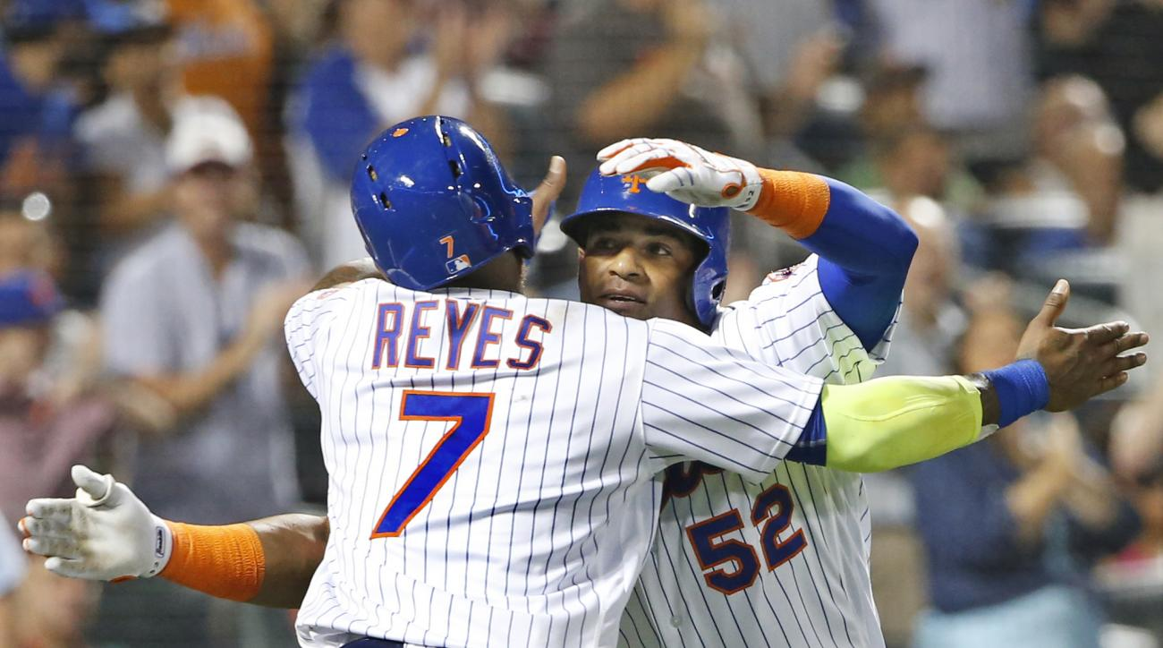 RETRANSMISSION TO CORRECT INNING TO FOURTH FROM FIFTH - New York Mets Yoenis Cespedes (52) embraces New York Mets Jose Reyes (7) after Reyes and Noah Syndergaard scored on Cespedes's fourth-inning, three-run, home run in a baseball game against the Philad