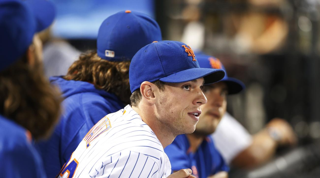 New York Mets starting pitcher Steven Matz, who is on the disabled list, watches a baseball game between the New York Mets and the Philadelphia Phillies from the dugout, Saturday, Aug. 27, 2016, in New York. (AP Photo/Kathy Willens)