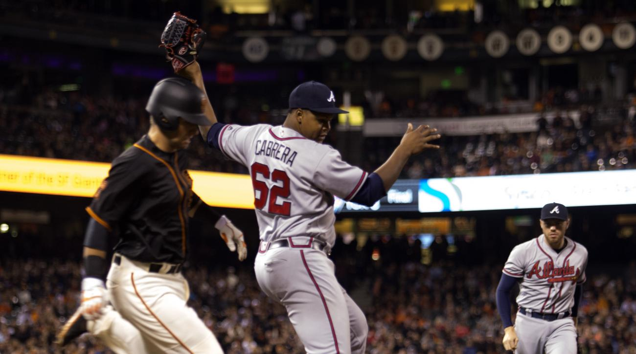 Atlanta Braves' Mauricio Cabrera (62) tags first base ahead of San Francisco Giants' Joe Panik, left, to quell an eighth inning rally during a baseball game, Saturday, Aug. 27, 2016, in San Francisco. (AP Photo/D. Ross Cameron)