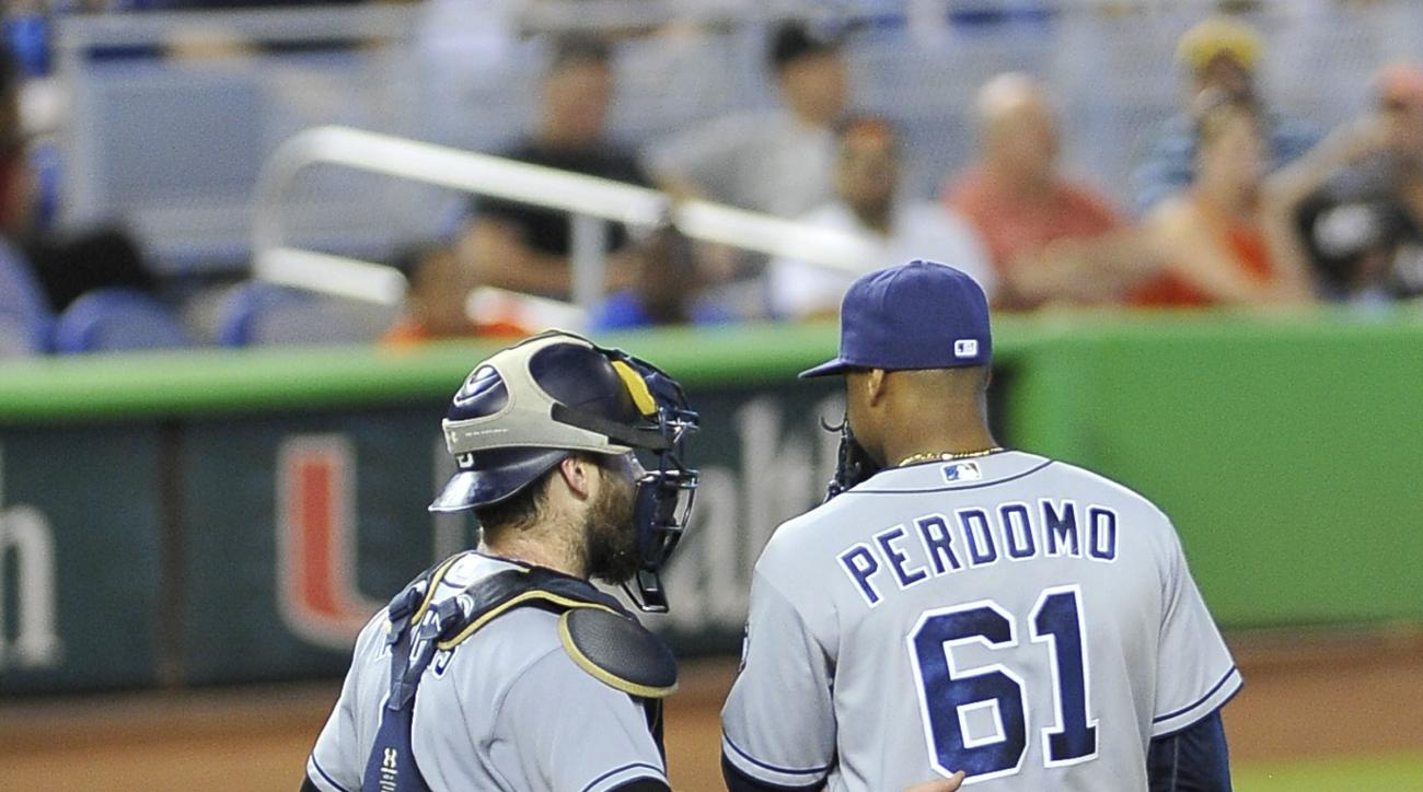 San Diego Padres' pitcher Luis Perdomo,right and catcher Derek Norris confer on the mound during the second inning of a baseball game against the Miami Marlins, Sunday, Aug. 28, 2016, in Miami. (AP Photo/Gaston De Cardenas)